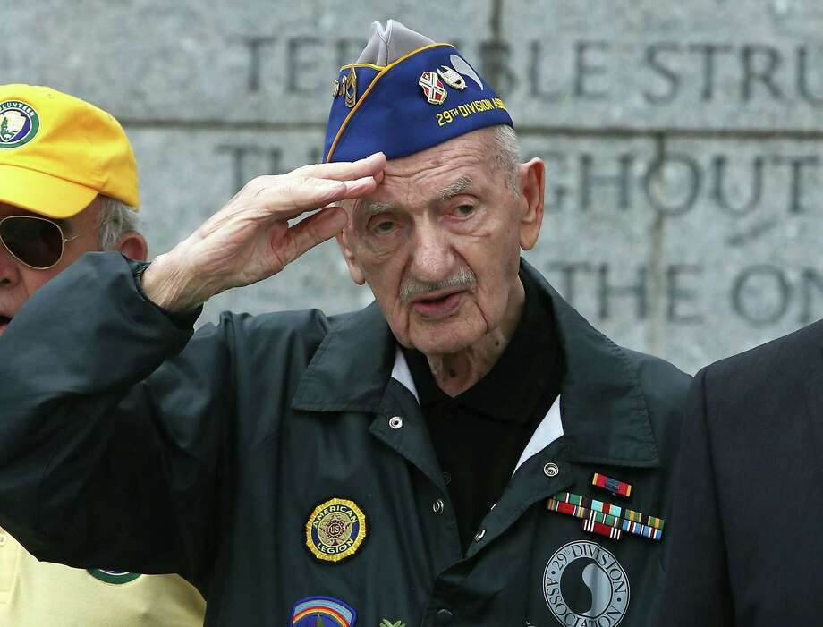WWII veteran Norman Duncan, 99, salutes during a D-Day anniversary wreath-laying ceremony at the National World War II Memorial on June 6 in Washington, D.C. A reader criticizes the newspaper for not covering the 74th anniversary of the historic allied landing, which hastened the end of the war. Photo: Mark Wilson /Getty Images / 2018 Getty Images