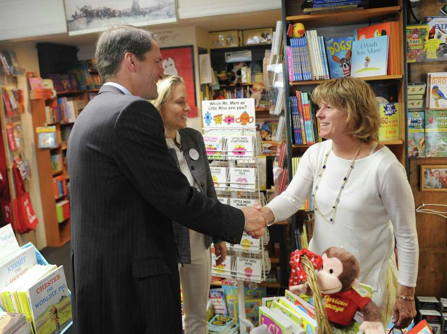 U.S. Rep. Jim Himes and Democratic State Senate candidate Alexandra Bergstein, center, chat with Diane's Books manager Theresa O'Connor at Diane's Books in Greenwich, Conn. Monday, June 11, 2018. Bergstein spoke briefly about her platform and then the two walked around town to chat with local business owners. Photo: Tyler Sizemore / Hearst Connecticut Media / Greenwich Time