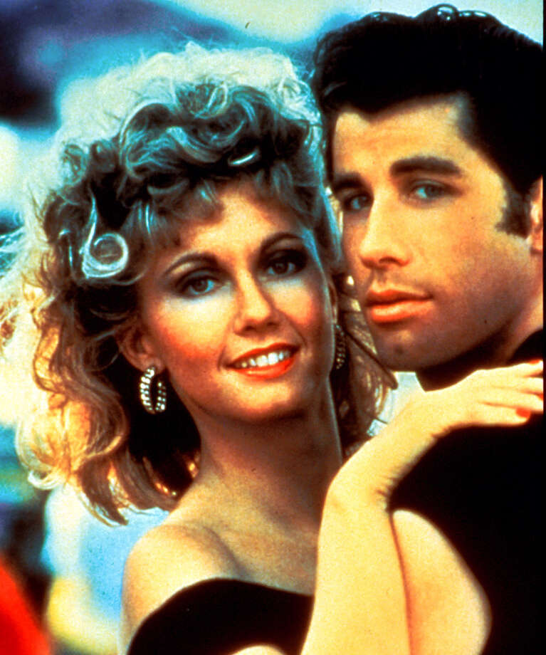 MV 135600000 1223_23 TBS 12-26-2001 9:00 PM Grease Best Bet Olivia Newton-John and John Travolta play  50s high-school sweethearts in 'Grease,' airing Wednesday, Dec. 26 on TBS (9-11 p.m. ET). 5x6 Color 72dpi Photos-Jay