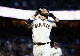 SAN FRANCISCO, CA - JUNE 04:  Brandon Crawford #35 of the San Francisco Giants points to the sky after hitting a home run in the fourth inning against the Arizona Diamondbacks at AT&T Park on June 4, 2018 in San Francisco, California.  (Photo by Ezra Shaw/Getty Images)