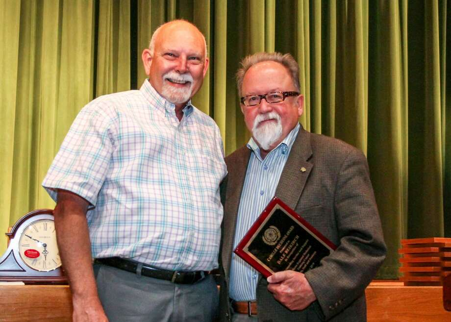 Matt Tarpley, director of the Midland College Williams Regional Technical Center in Fort Stockton, left, presents the Camille Duchesne Award to Dale Beikirch, dean of adult and continuing education. Photo: Katherine Curry