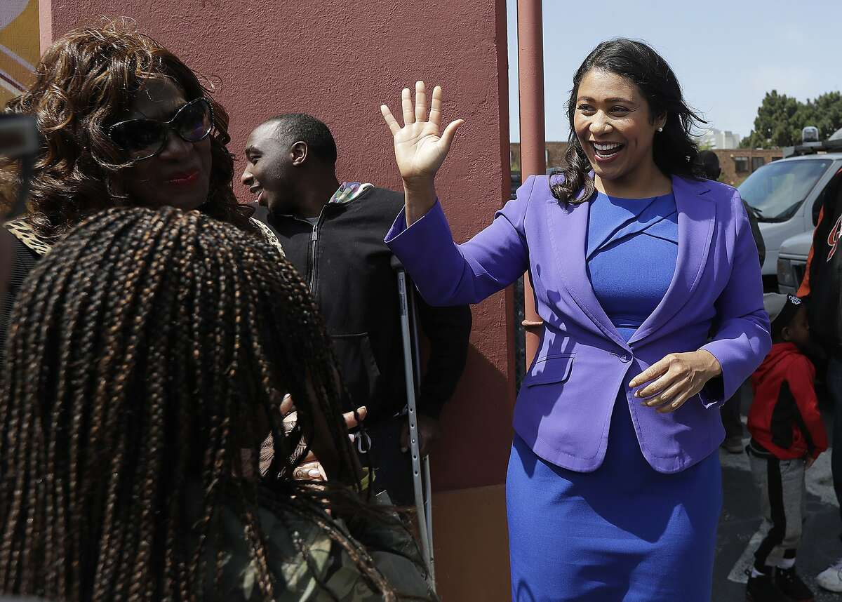 Board of Supervisors President London Breed, right, greets supporters after speaking to reporters in San Francisco, Wednesday, June 6, 2018. Former state Sen. Mark Leno pulled ahead in San Francisco's race for mayor by the slimmest of margins early Wednesday under the city's unusual voting system, although Breed maintained her lead in first-place votes. (AP Photo/Jeff Chiu)