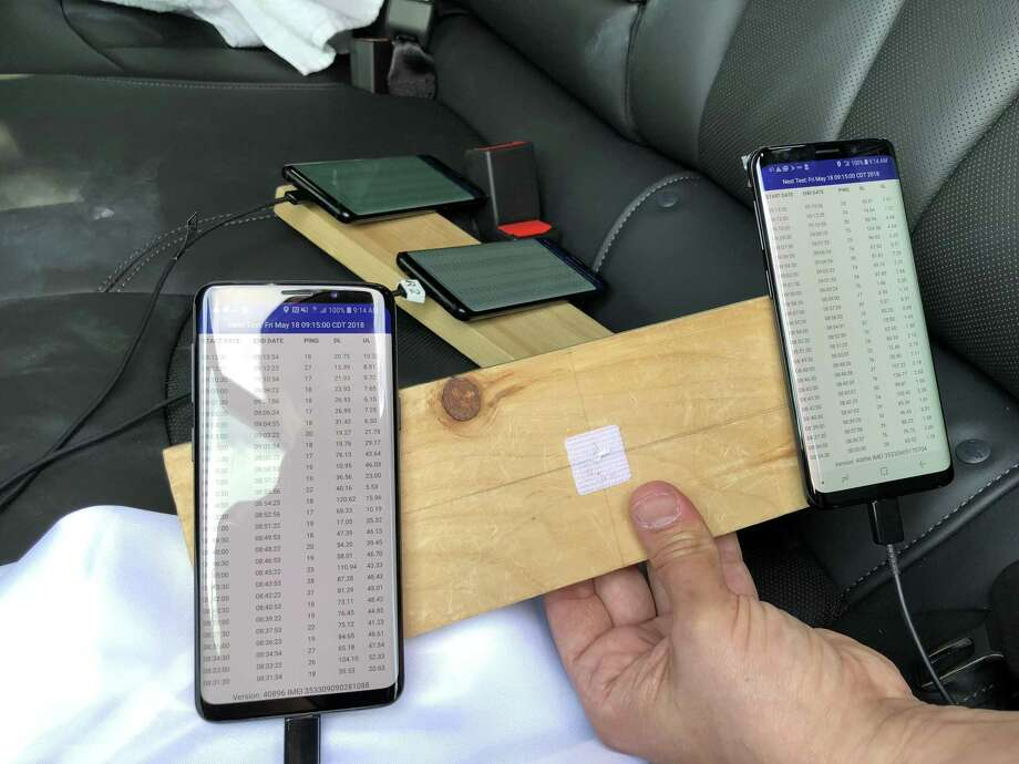 Michael Muchmore of PC Magazine drove around Houston on May 18, 2018, with four smartphones, one for each of the major carriers, testing cellular connections around town for the publication's annual cell-service survey. Photo: Dwight Silverman / Houston Chronicle