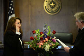Dean Rucker, presiding judge of the Seventh Administrative Judicial Region of Texas, swears in Ellen Griffith, associate judge of the child protection court, June 11, 2018, at the Midland County Courthouse. James Durbin/Reporter-Telegram