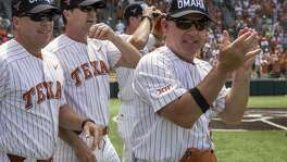 Texas head coach David Pierce, right, celebrates a 5-2 win over Tennessee Tech during an NCAA Super Regional at UFCU Disch-Falk Field in Austin, Monday, June 11, 2018. (Stephen Spillman / for Express-News)