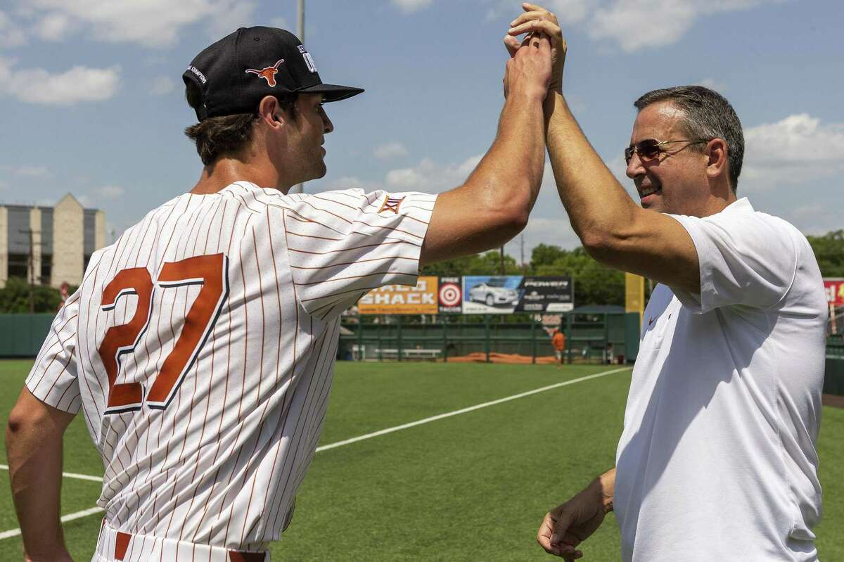 Texas' Blair Henley and Texas athletic director Chris Del Conte celebrates a 5-2 win over Tennessee Tech during an NCAA Super Regional at UFCU Disch-Falk Field in Austin, Monday, June 11, 2018. (Stephen Spillman / for Express-News)