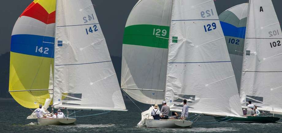 "Rodrigo Meireles of Norwalk,sailing in boat 129 (center), narrowly defeated perennial CPYC Atlantics favorite Scott Reichhelm of Westport, CT, taking first in three of five races to win the Atlantics class competition at the Cedar Point Yacht Club's ""One Design"" Regatta earlier this month. Photo: Contributed Photo"