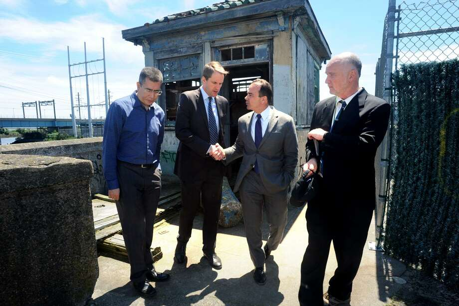 Congressman Jim Himes shakes hands with Mayor Joe Ganim as they tour what remains of the Congress Street bridge, in Bridgeport, Conn. June 11, 2018. The bridge has been closed to traffic for over twenty years, and part of the structure spanning the Pequonnock River was demolished in 2010. Photo: Ned Gerard / Hearst Connecticut Media / Connecticut Post
