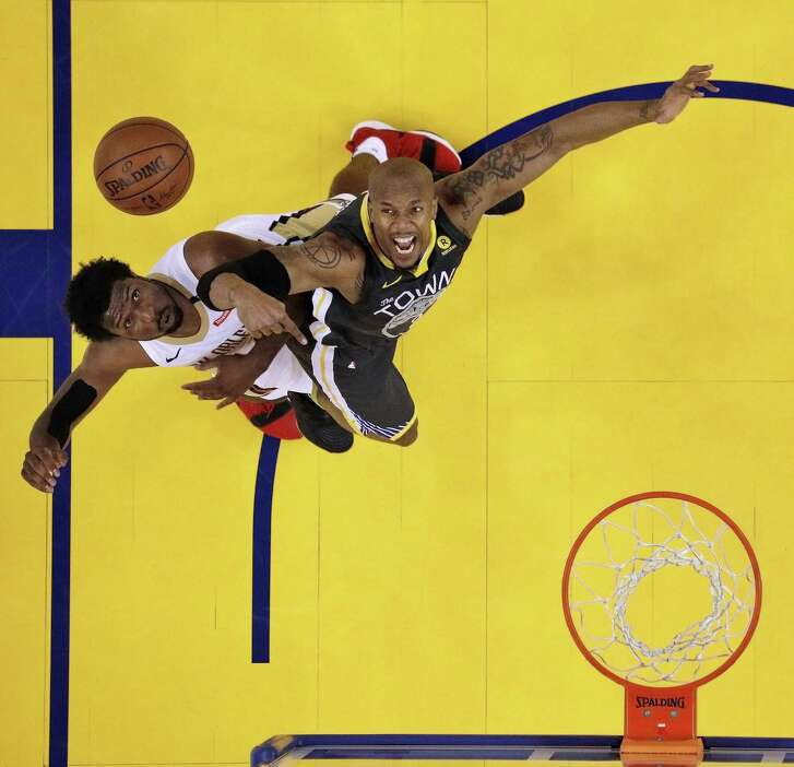 David West boxes out the Pelicans' Solomon Hill during Game 2 of the conference semifinals in Oakland. West, 37, played 13 title-free seasons before coming to the Warriors — he's now won championships in consecutive seasons.