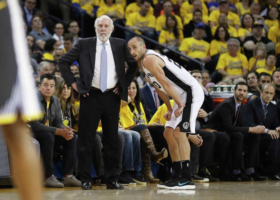 San Antonio Spurs' head coach Gregg Popovich and Manu Ginobili look on in the third quarter during game 2 of round 1 of the Western Conference Finals at Oracle Arena on Monday, April 16, 2018 in Oakland, Calif. Photo: Scott Strazzante / The Chronicle / online_yes
