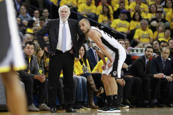 San Antonio Spurs' head coach Gregg Popovich and Manu Ginobili look on in the third quarter during game 2 of round 1 of the Western Conference Finals at Oracle Arena on Monday, April 16, 2018 in Oakland, Calif.