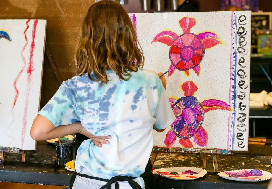 """Lillian Prince, 11, of Girl Scout Troop 436, paints one of the decorative ceiling tiles that will be displayed in the children's rooms at North Central Baptist Hospital. The work is part of Girl Scout Troop 1335's """"Healing Ceilings"""" project. Photo: Marvin Pfeiffer /San Antonio Express-News / Express-News 2018"""