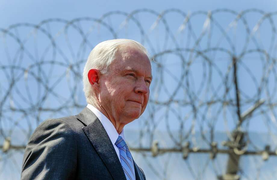 FILE - In this April 21, 2017 file photo, with razor wire across the top of the secondary border fence behind him, U.S. Attorney General Jeff Sessions attends a news conference at the U.S.-Mexico border next to the Brown Field Border Patrol Station in San Diego.  Immigration judges generally cannot consider domestic and gang violence as grounds for asylum, U.S. Attorney General Jeff Sessions said Monday, June 11, 2018 in a ruling that could affect large numbers of Central Americans who have increasingly turned to the United States for protection. (Hayne Palmour IV/The San Diego Union-Tribune via AP, File) Photo: Hayne Palmour IV, Associated Press