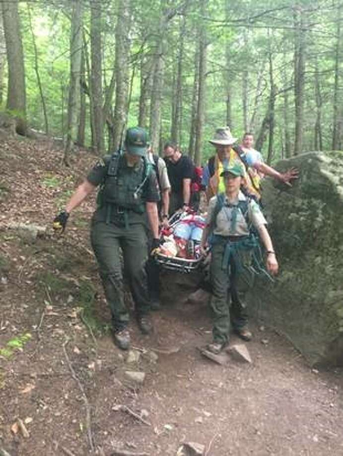 Forest rangers carry an injured 61-year-old woman from New Jersey off Algonquin in Essex County, N.Y. onFriday, June 8, 2018. Photo: NYS DEC