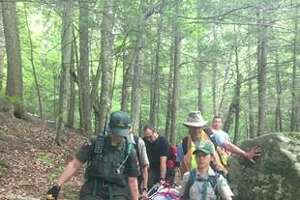 Forest rangers carry an injured 61-year-old woman from New Jersey off Algonquin in Essex County, N.Y. onFriday, June 8, 2018.