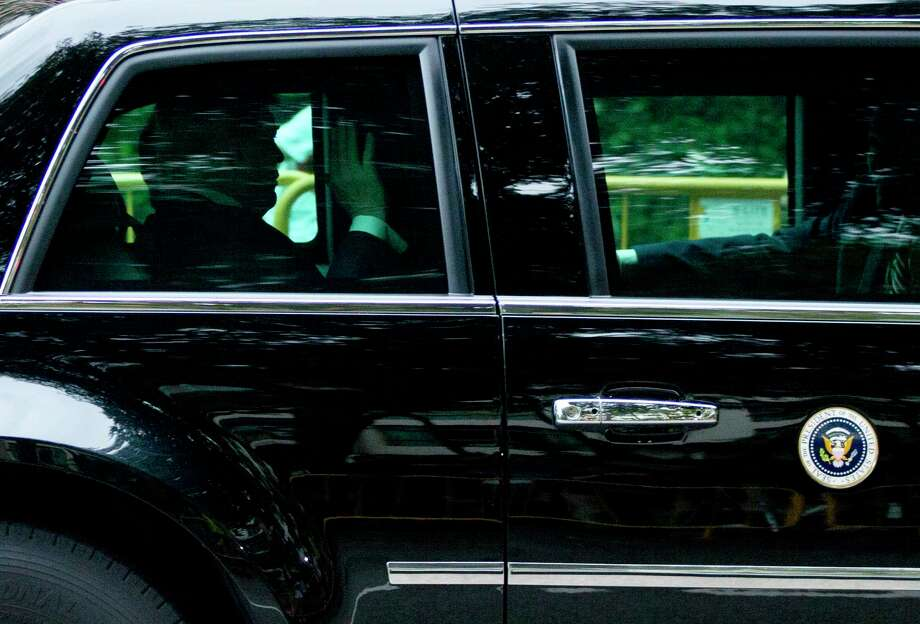 U.S. President Donald Trump waves as his motorcade leaves Shangri-La hotel in Singapore Tuesday, June 12, 2018, ahead of the summit with North Korea leader Kim Jong Un. (AP Photo/ Gemunu Amarasinghe) Photo: Gemunu Amarasinghe, Associated Press / Copyright 2018 The Associated Press. All rights reserved.