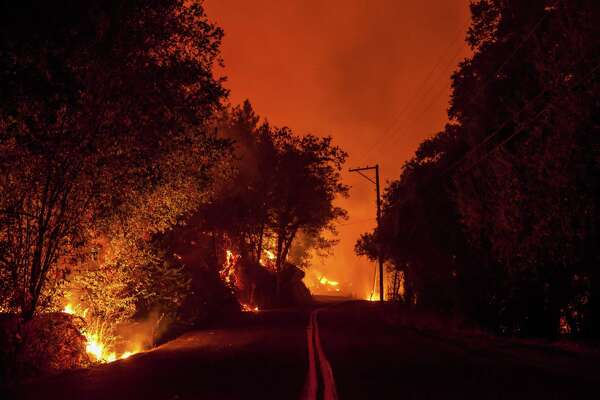 Flames progress along both sides of Mount Veeder Road as the Nuns Fire burns west of downtown Napa on Oct. 10, 2017.