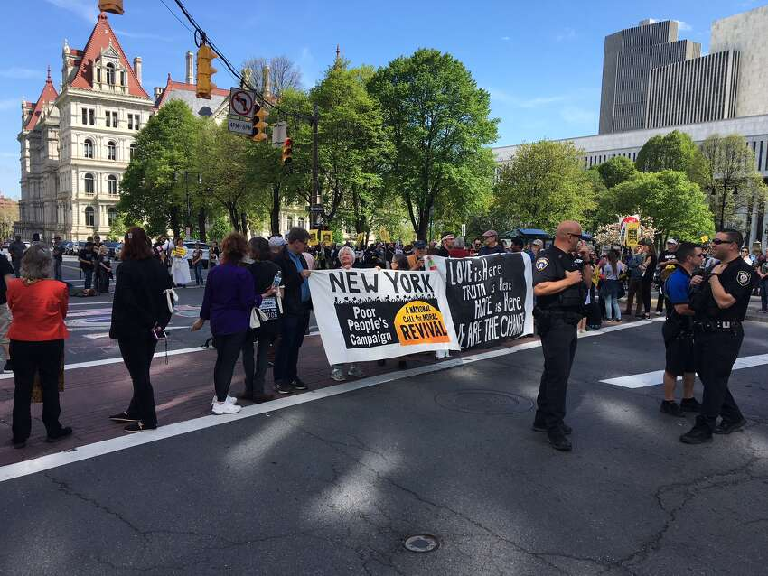 Poor People's Campaign protesters block traffic at Washington Avenue and South Swan Street in Albany on Monday, May 14, 2018. (Rex Smith / Times Union)