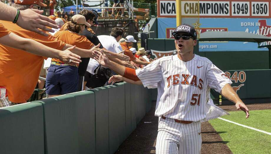 Jake McKenzie joins the fans in celebrating a trip to the College World Series in Omaha, where Texas, which will be making its 36th appearance, will seek its seventh national title and first since 2005. Photo: Stephen Spillman / Stephen Spillman / stephenspillman@me.com Stephen Spillman