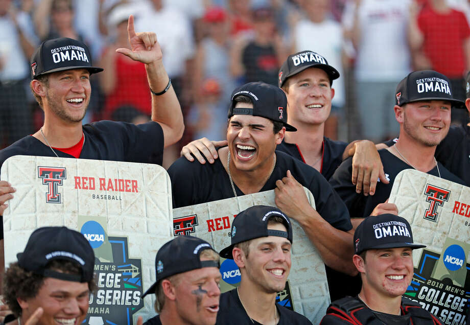 Texas Tech players pose for pictures after an NCAA college baseball tournament super regional game against Duke, Monday, June 11, 2018, in Lubbock, Texas. (Brad Tollefson/Lubbock Avalanche-Journal via AP)