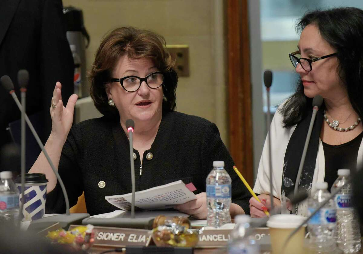New York State Commissioner of Education MaryEllen Elia, left, addresses those gathered for a New York State Education Department Board of Regents meeting on Monday, June 11, 2018, in Albany, N.Y. Board of Regents Chancellor Betty Rosa, right, looks on. (Paul Buckowski/Times Union)