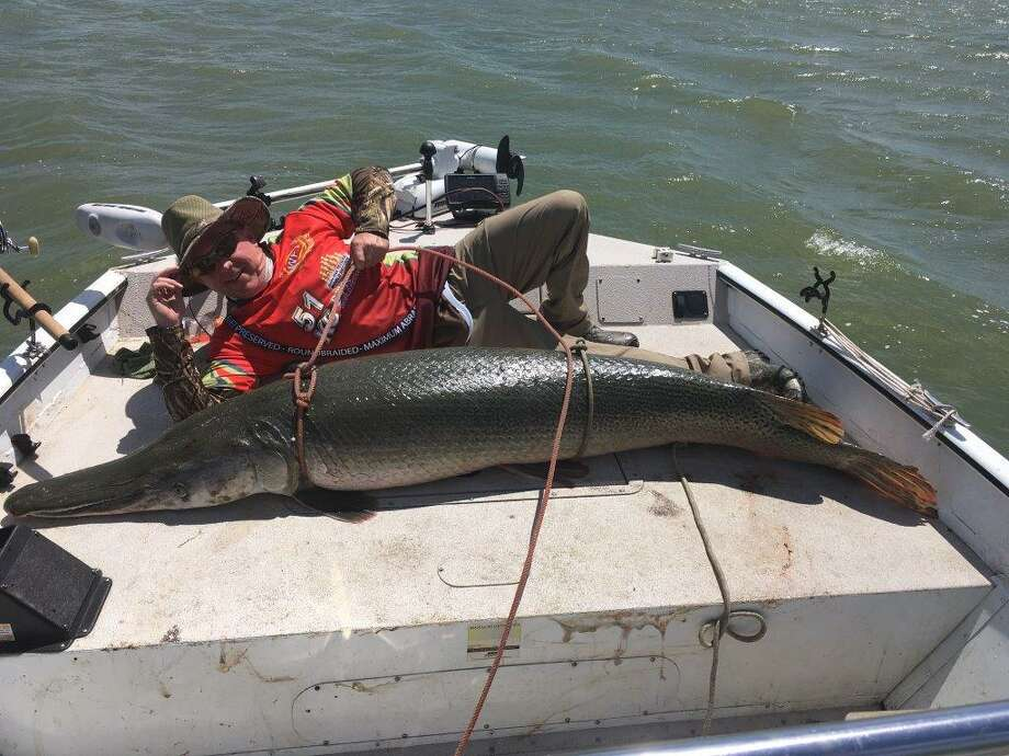 Midland's Rock Shaw poses with this 228-pound alligator gar, which he caught Saturday at Choke Canyon Reservoir in Calliham. Shaw broke his own lake record for the second time in a week before it was passed by another angler Sunday. Courtesy photo