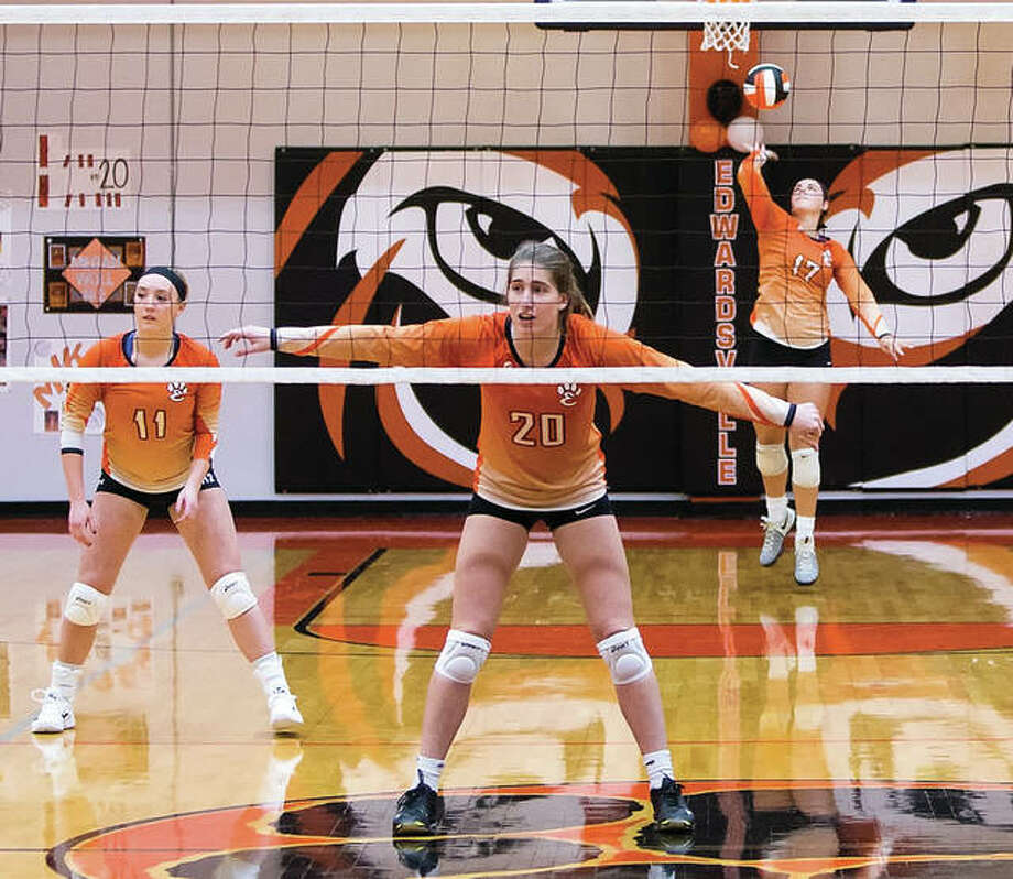 Edwardsville's Rachel Pranger serves while Kate Martin (20) and setter Rachel Verdun (left) wait for action during a win over Belleville West that clinched the SWC title on Oct. 17 in Edwardsville. All three of those seniors, plus libero Megan Woll, earned first-team All-SWC honors for a 32-6 squad that also lost its head coach. Photo:       Scott Kane / For The Telegraph