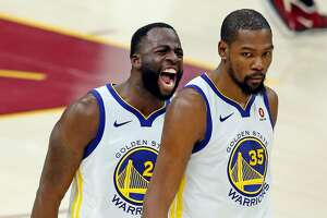 Golden State Warriors' Draymond Green exults after Kevin Durant hit 3-pointer late in 4th quarter of Warriors' 110-102 win over Cleveland Cavaliers in Game 3 of the NBA Finals at Quicken Loans Arena in Cleveland, OH on Wednesday, June 6, 2018.