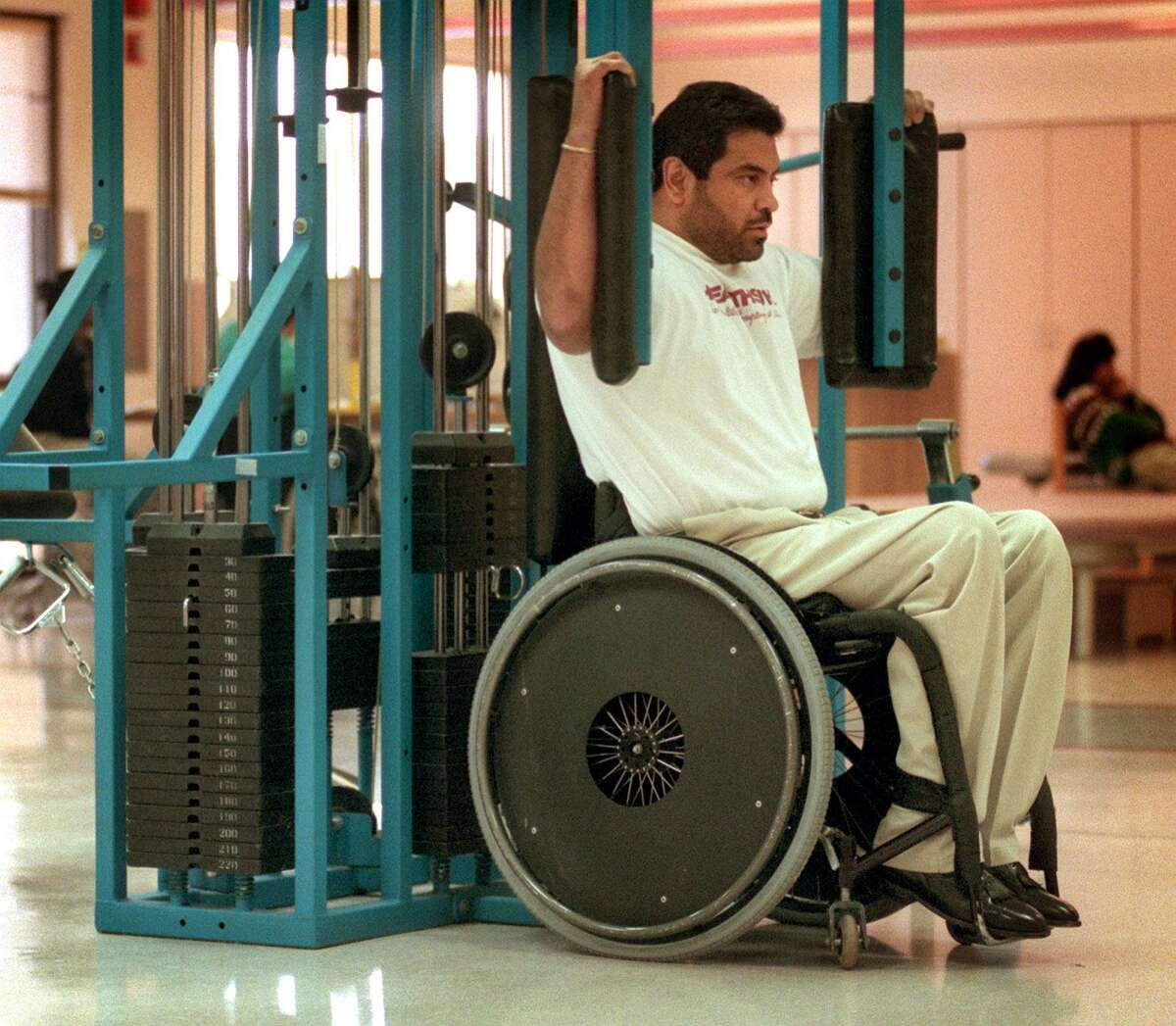 A patient uses a specially designed gym at HealthSouth Rehabilitation Institute of San Antonio in this 1999 photo.