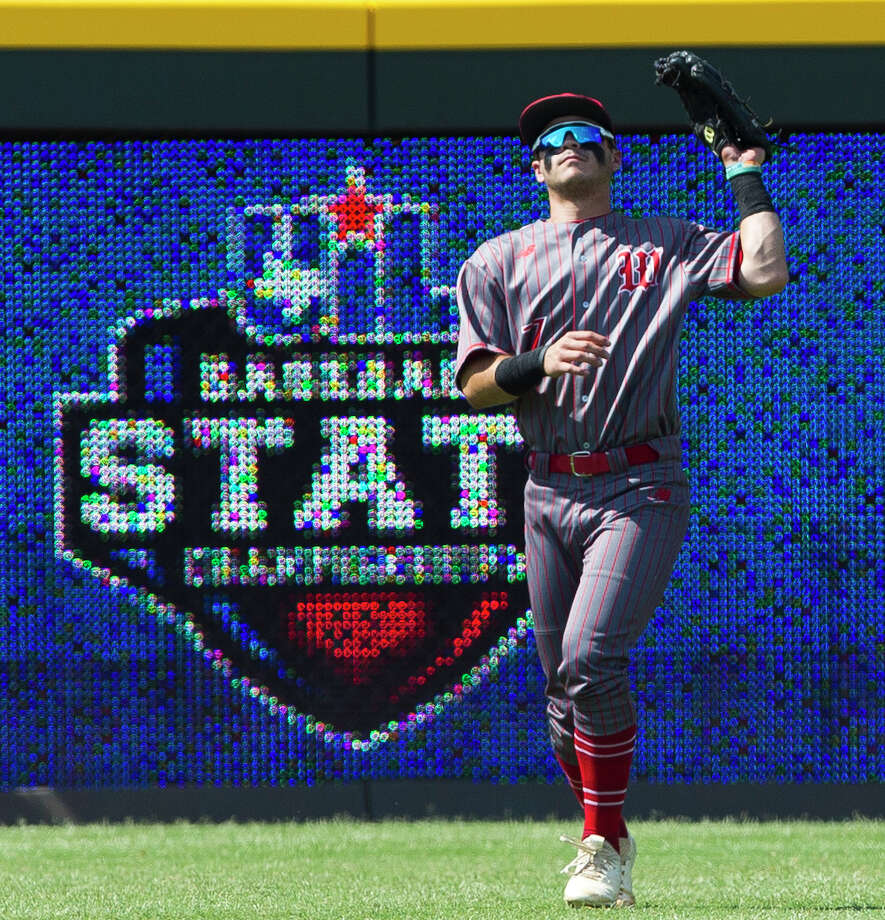 The Woodlands left fielder Zayne Watson (7) fields a fly ball by Nik Millsap #32 of Southlake Carroll in the first inning of a Class 6A state semifinal game during the UIL State Baseball Championships at Dell Diamond on Friday, June 8, 2018, in Round Rock. Photo: Jason Fochtman/Houston Chronicle / ? 2018 Houston Chronicle