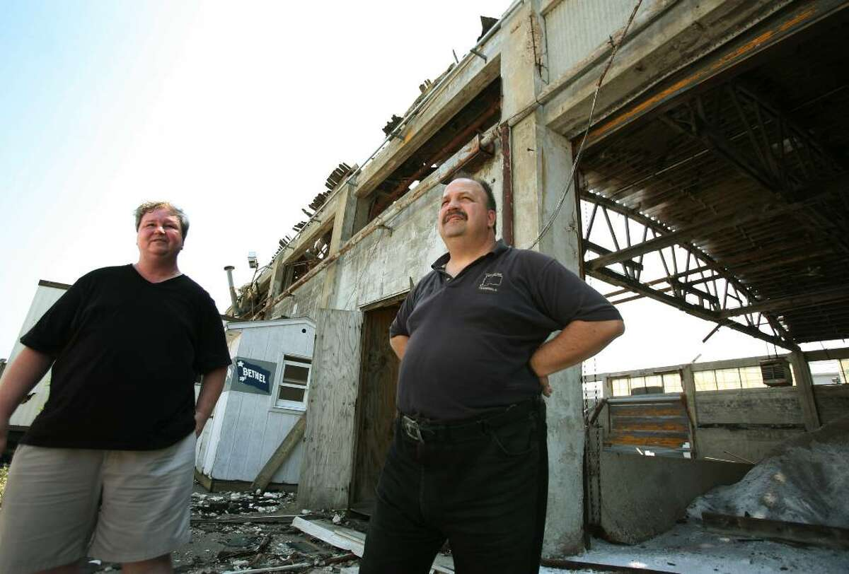 Longshoremen Mike Carrafiello, left of Shelton, and Dave Shuda of Wallingford, at the union-owned Cilco Terminal off Seaview Avenue in the East End of Bridgeport. The union is selling the property to fund it's pension plan.