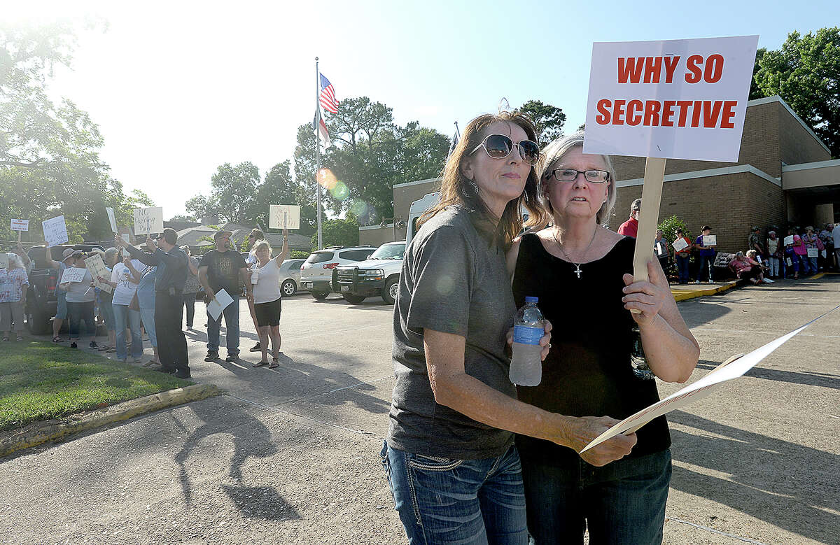 Hundreds assembled outside the Woodville City Council meeting to express their concerns and opposition to the East Texas Packing meat processing facility. Many citizens have expressed opposition to the company's location at the Tyler County Industrial Park. Although county officials say they have no authority to stop the building of the facility, they have urged citizens to continue voicing their concerns in the hope that the company will withdraw its plans to locate in Tyler County. Photo taken Monday, June 11, 2018 Kim Brent/The Enterprise