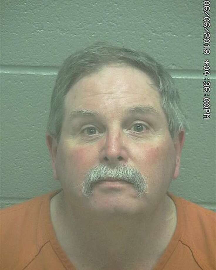 Justin H. Lewis, 57, was arrested June 6 after he allegedly pulled a gun on a man, according to court documents. Photo: Midland County Sheriff's Office