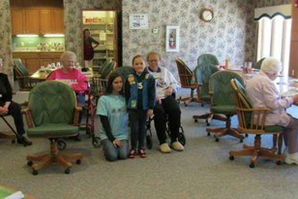 The Girl Scouts Hometown Hero Day was April 28. Louise Barrios, senior Girl Scout, and Erin Brannan, Daisy Girl Scout from Caseville, honored the elderly at Country Garden in Pigeon. They decided the elderly have given to the community throughout their lives. The girls donated 100 boxes of Girl Scout cookies. They met with several of the residents and spoke with them. Later, more of the residents came to the community area and enjoyed the cookies left for them. (Submitted Photo)