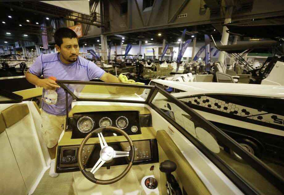 Henry Garcia works to clean a 23 foot Sea Ray boat  Monday, June 11, 2018, in Houston in the Marine Max area for the Houston Summer Boat Show that opens June 13 through June 17 at NRG Center. ( Melissa Phillip / Houston Chronicle ) Photo: Melissa Phillip, Staff / Houston Chronicle / © 2018 Houston Chronicle