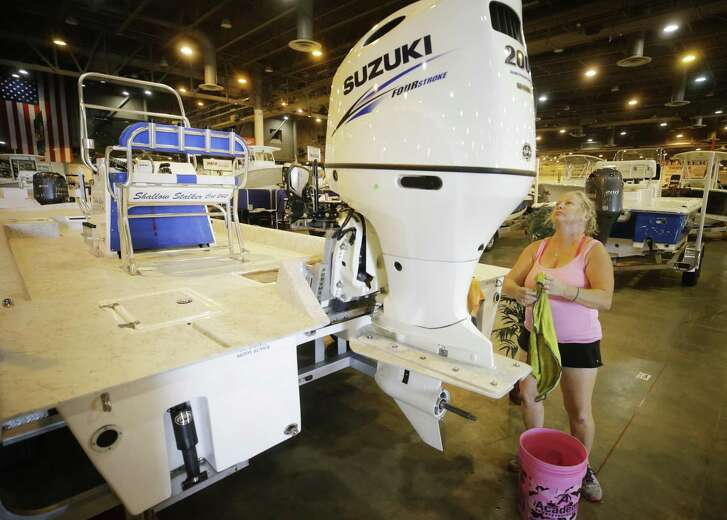 Sherry Potter, of Galveston with R&S Yacht Service, works to clean a 24 foot Shallow Stalker boat Monday, June 11, 2018, in Houston in the Gulf Coast Marine area for the Houston Summer Boat Show that opens June 13 through June 17 at NRG Center. ( Melissa Phillip / Houston Chronicle )