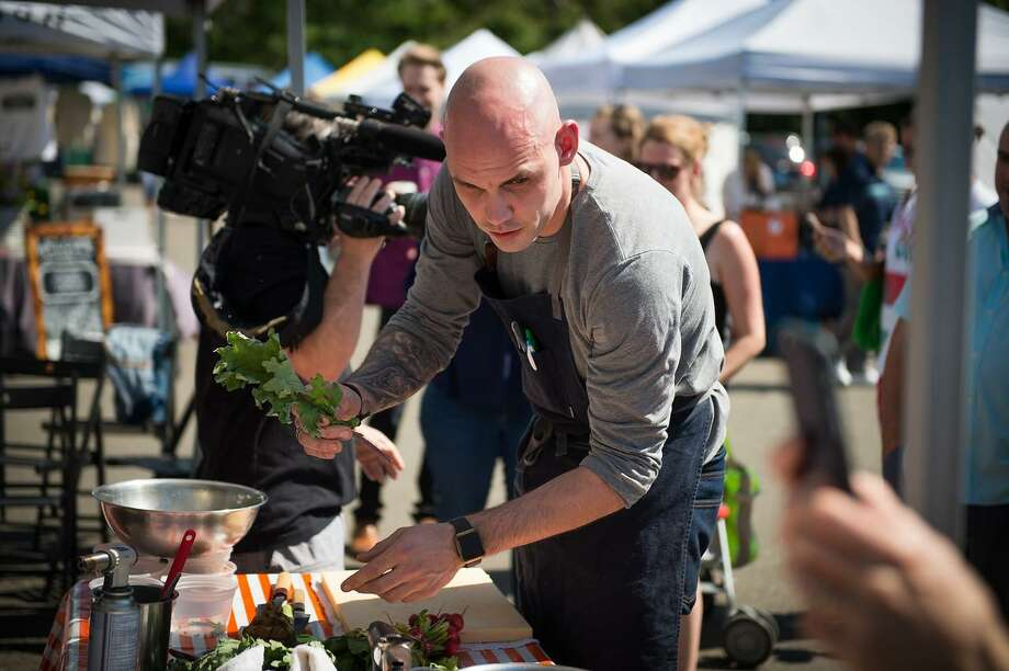 "Christian Wilke of the Westport restaurants OKO and The Cottage competes on May 24, 2018, in the inaugural ""Chef-at-the-Market"" contest in Westport, Conn., in which chefs pull together a dish from scratch at the Westport Farmers Market with $20 of food purchased from market stalls. Photo: Eileen Clark Sawyer / Contributed Photo / Eileen Clark Sawyer"