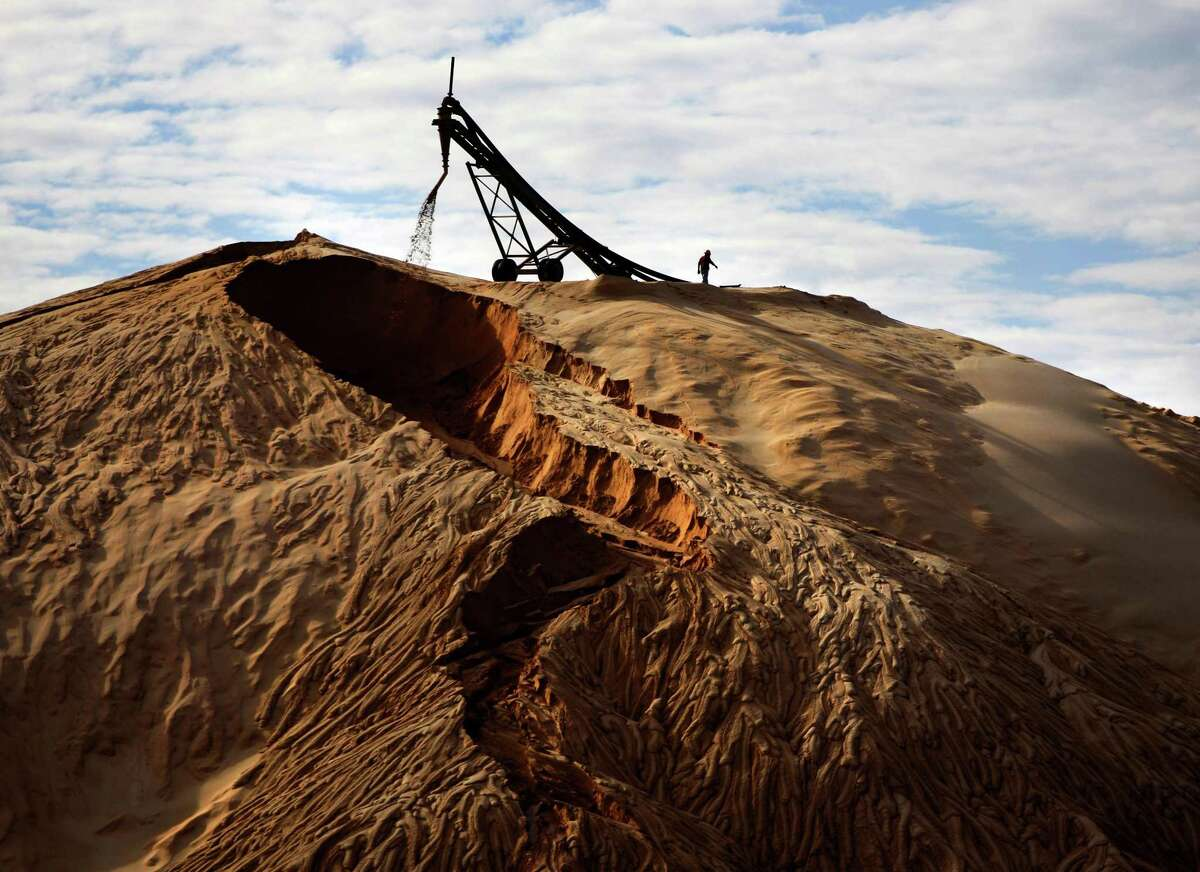 Sand for the Eagle Ford Shale is seen near Voca in 2014. The amount of sand used in Texas oil and gas basins is on the rise.
