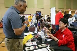 Della Lopez (right) with the Texas Veterans Commission speaks with Ramon Gonzales during the seventh annual Welcome Home event honoring service members and their families at Morgan's Wonderland on Saturday, May 19, 2018.  The event, hosted by the South Texas Veterans Health Care System, brought together community partners offering service and support to the Veteran and military communities to one location in a fun, family environment.  MARVIN PFEIFFER/mpfeiffer@express-news.net