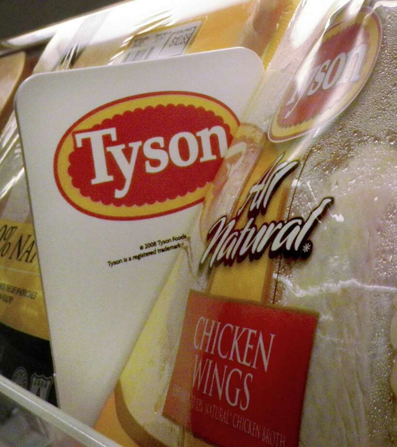 FILE - In this May 3, 2009 file photo, Tyson Foods chicken products are displayed on the shelves of a Little Rock, Ark. grocery store. is pulling about 3,120 pounds of frozen breaded chicken products from shelves because they may be contaminated with extraneous materials, specifically blue and clear soft plastic, according to the U.S. Department of Agriculture's Food Safety and Inspection Service.(AP Photo/Danny Johnston, file) Photo: Danny Johnston / AP / AP2009