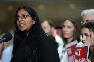 City Council member Kshama Sawant holds a press conference before a City Council vote to repeal the big business head tax, which was voted for unanimously last month, Tuesday, June 12, 2018. Sawant said a repeal would be cowardly and giving into Amazon.
