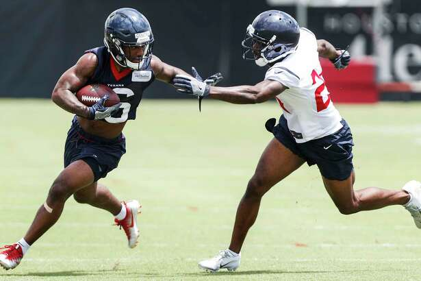 Houston Texans wide receiver Keke Coutee (16) runs against cornerback Johnathan Joseph during mini camp at The Methodist Training Center on Tuesday, June 12, 2018, in Houston.
