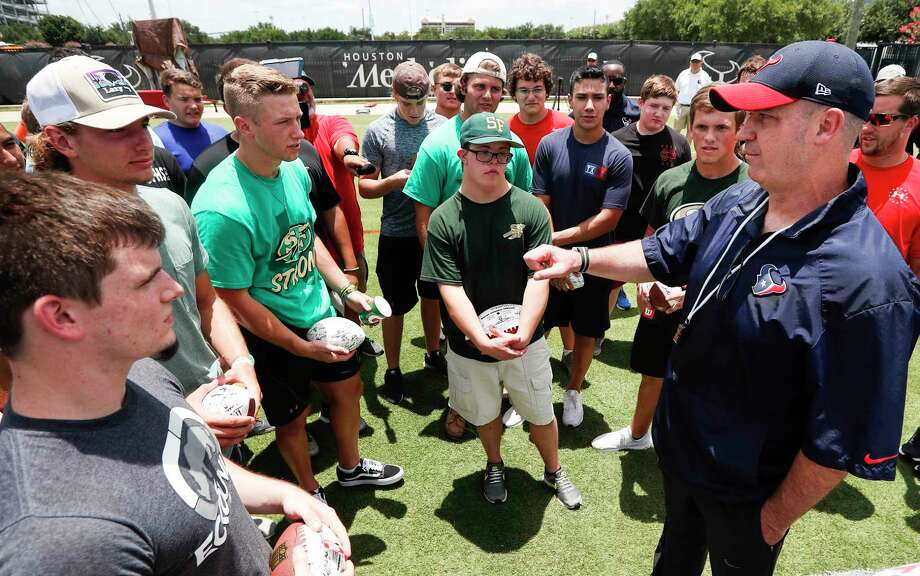 Houston Texans head coach Bill O'Brien talks to a group of Santa Fe High School football players following Texans mini camp at The Methodist Training Center on Tuesday, June 12, 2018, in Houston. Photo: Brett Coomer, Houston Chronicle / © 2018 Houston Chronicle
