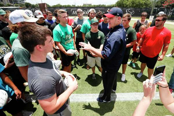 Houston Texans head coach Bill O'Brien talks to a group of Santa Fe High School football players following Texans mini camp at The Methodist Training Center on Tuesday, June 12, 2018, in Houston.