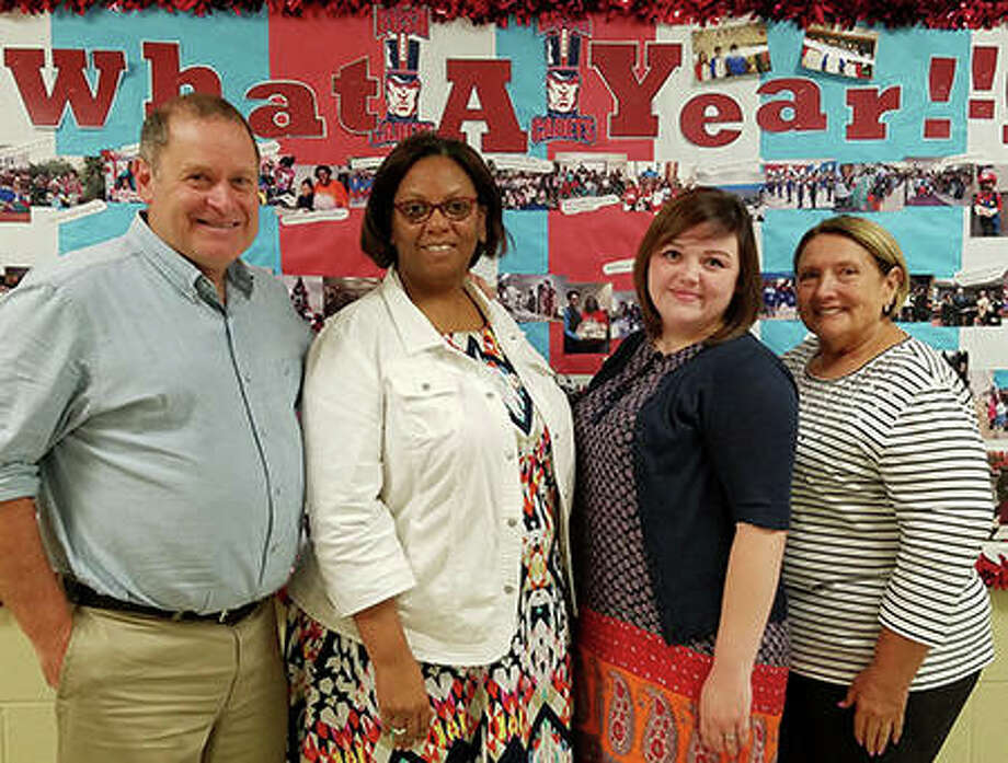 (L-R) SIUE's Brian Johnson, PhD, stands alongside Gordon Bush Elementary's Carmalita Neely, SIUE senior Abigail Cline, and Gordon Bush Elementary's Gloria Oggero. Photo:       For The Telegraph