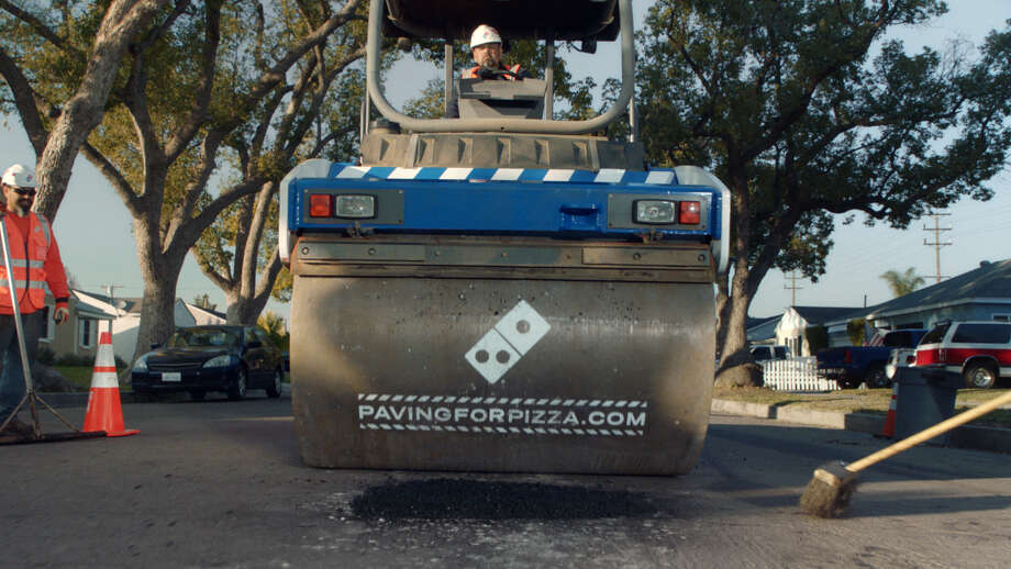 Domino's is inviting residents to nominate their own town for repaving as part of its #pavingforpizza program to keep their pizzas from getting ruined on the ride home. The company has already partnered with four municipalities to fix the local roads. Nominate your town at pavingforpizza.com. (Photo from Domino's)