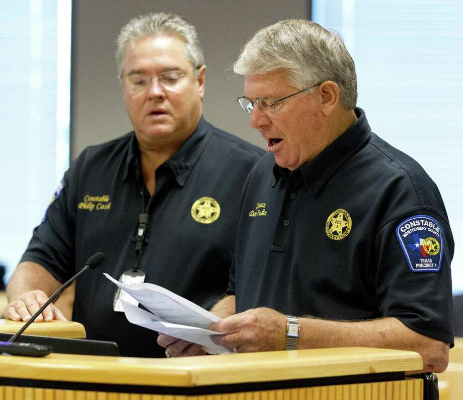 Captain Don Fullen, with the Montgomery County Precinct 1 Constable's Office, speaks beisde Precinct 1 Constable Philip Cash during County Commissioners Court at the Alan B. Sadler Commissioners Court Building, Tuesday, June 12, 2018, in Conroe. Photo: Jason Fochtman, Staff Photographer / Houston Chronicle / © 2018 Houston Chronicle