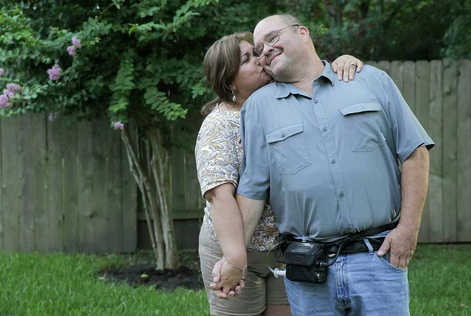 Daniel and Nelly Reed in the backyard of her cousin's Humble, Texas home during a trip to the Houston area looking for housing on Saturday, June 9, 2018 in Humble.  Reed, who is from Rio Grande Valley, currently has an left ventricular assist device from St. Luke's and will eventually need a heart transplant. Photo: Elizabeth Conley, Houston Chronicle / ©2018 Houston Chronicle