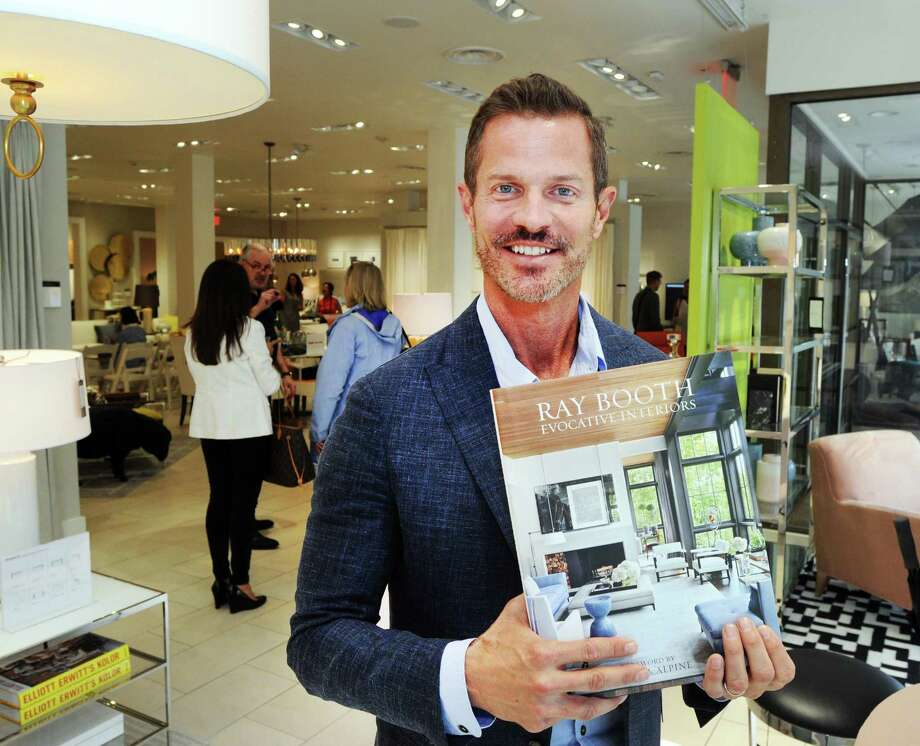 "Interior designer Ray Booth of the design firm McALPINE with his book ""Evocative Interiors,"" at the Mitchell Gold + Bob Williams store during the Greenwich Design District's Day of Design on Tuesday. Photo: Bob Luckey Jr. / Hearst Connecticut Media / Greenwich Time"
