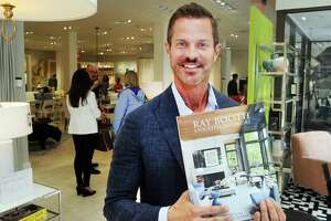 """Interior designer Ray Booth of the design firm McALPINE with his book """"Evocative Interiors,"""" at the Mitchell Gold + Bob Williams store during the Greenwich Design District's Day of Design on Tuesday."""